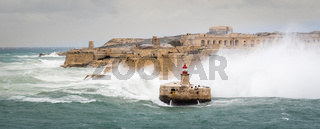 Ricasoli East Breakwater and Lighthouse withstand raw sea and high waves
