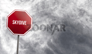 skydive - red sign with clouds in background