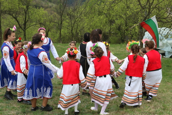 The girls decorate in a colorful and rich way their hairs and go around the village
