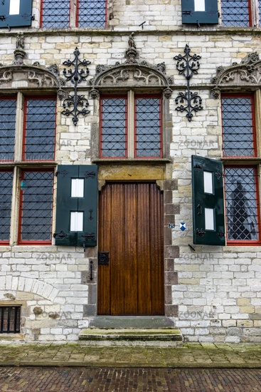 Historic building in the Netherlands with a brown wooden door