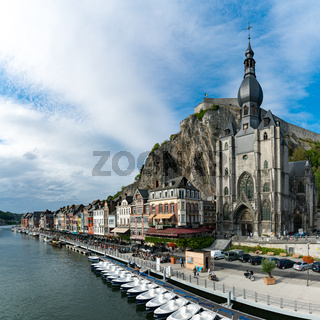 square format view of the Meuse River and the historic old riverside town of Dinant in Belgium