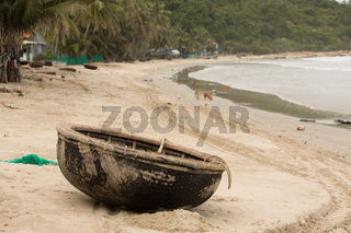 Vietnamese basket Boat Thung Chai in the sand