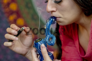 Young Brunette Model Smoking Marijuana
