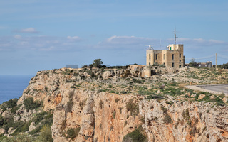 Beautiful Landscape with a old, lonely House on Dingli Cliffs and street on a sunny day.