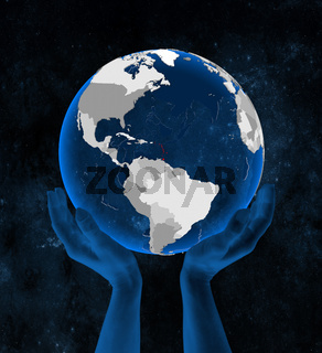 Caribbean on globe in hands