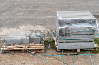 Gray stones on the wooden pallets