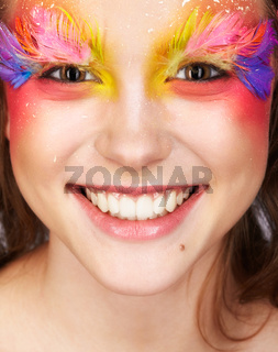 Female with fashion feather eyelashes make-up