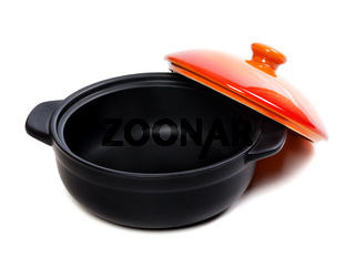 Open black pot for stove with red lid