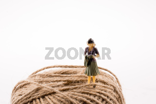 Woman with a linen spool of thread