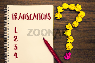 Text sign showing Translations. Conceptual photo Written or printed process of translating words text voice Notepad paperwork marker pen ask idea pure wood mistakes several tries.