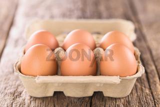 Raw Brown Eggs in Egg Box or Carton
