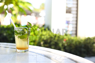 Mojito cocktail on the table outdoors. Concept of luxury vacation