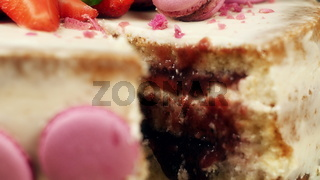cake with a cut out with decoration of macaroons, strawberries and lilac, 4K slow mo