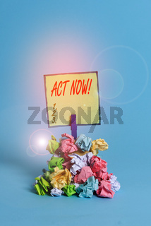Conceptual hand writing showing Act Now. Business photo text fulfil the function or serve the purpose of Take action Do something Reminder pile colored crumpled paper clothespin wooden space.