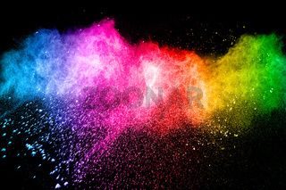 Multicolored powder explosion on black background. Color dust splash cloud on background