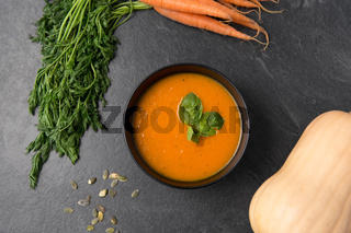 close up of pumpkin cream soup and vegetables