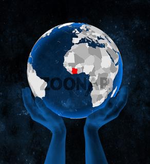 Ivory Coast on globe in hands