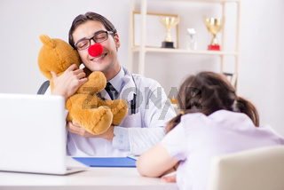 Funny pediatrician with little girl at regular check-up
