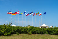 National flags of different countries on the waterfront.