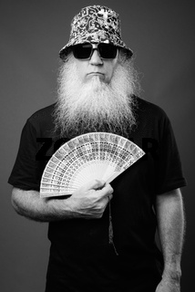 Mature man with long white beard in black and white