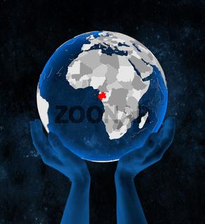 Gabon on globe in hands