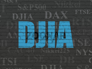 Stock market indexes concept: DJIA on wall background