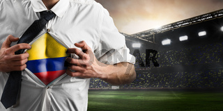Colombia soccer or football supporter showing flag