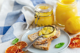 Slice of wholegrain bread with lemon custard.