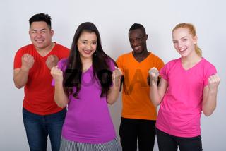 Studio shot of happy diverse group of multi ethnic friends smili