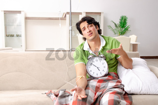 Young man suffering at home