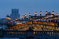 People on Patriarch bridge in winter evening