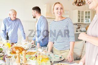 Big Happy Family Setting Dinner Table