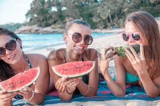 Female friends eating watermelon