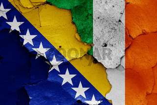 flags of Bosnia and Herzegovina and Ireland painted on cracked wall