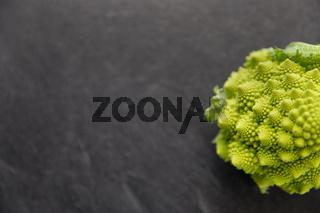 close up of romanesco broccoli on slate stone