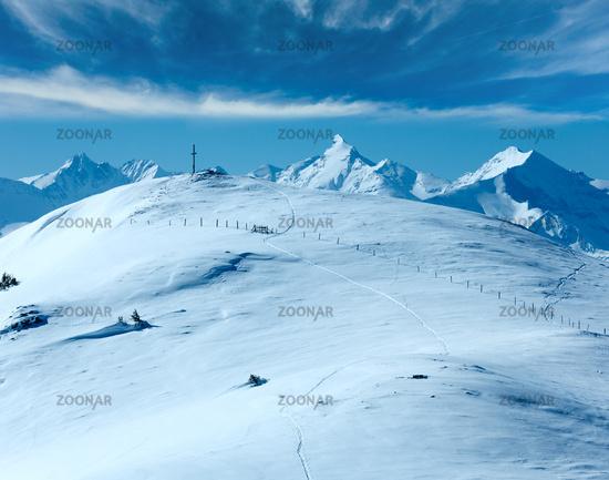 Cross on winter mountain top