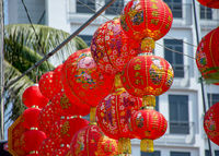 Decorative Red round Chinese lanterns hanging out for sale on the run up to Chinese New Year.