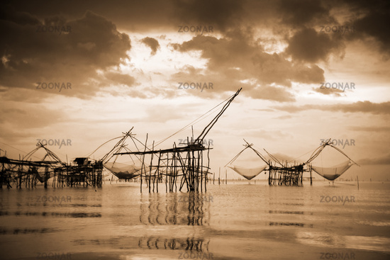 Old photo local fishing tool in sepia warm vintage style, Thailand