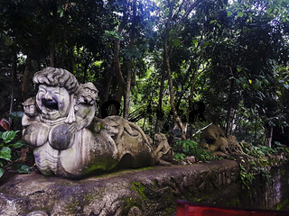 Statue at the inside entrance to the Monkey Forest, Ubud, Bali, Indonesia.