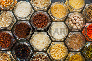 Food pattern background - beans and cereals in jars