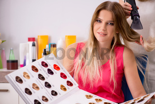 Customer choosing colour for her hair
