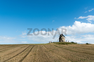 tourists visit the famous and historic Moidrey Windmill near Le Mont Saint-Michel in France