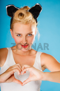 Pin up style, retro girl with heart sign.
