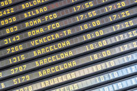 Flight information board at spanish airport terminal