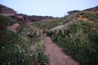 Sonnenuntergang an einer Steilküste in Nordspanien