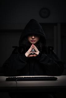 Female hacker hacking security firewall late in office