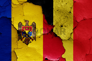 flags of Moldova and Belgium painted on cracked wall