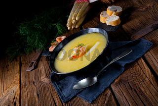 Super delicious asparagus soup with crab and capers .
