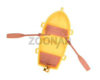 Plastic old small boat isolated on white background