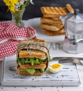 sandwich of French toast and lettuce leaves and boiled egg